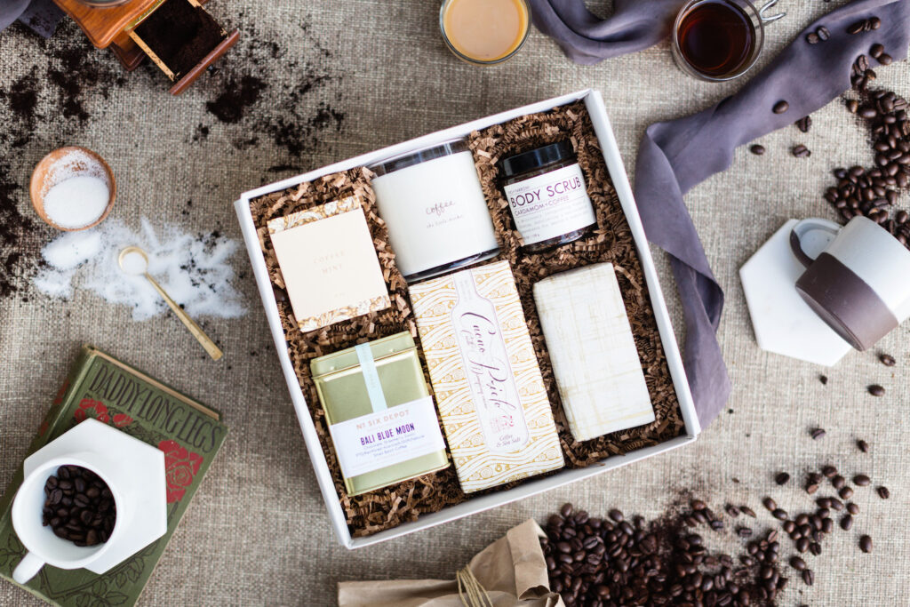 Coffee themed giftbox and flatlay. Featuring body selfcare products to other fun items.